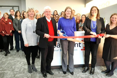 Participating in the ribbon cutting were (from right) Beth Kmiec, ClearPoint trust administration executive vice president; Tricia Miller, Batesville Area Chamber of Commerce executive director; Ashlee Theising, ClearPoint president and chief operating officer; Mayor Mike Bettice; Sarah Lamping, the city's economic development director; as well as other ClearPoint employees.