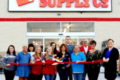 Tractor Supply Co. Batesville store manager Jen Monier (with scissors) cuts the ribbon to officially open the business Oct. 3. Helping her are (front row from left) Batesville Area Chamber of Commerce office coordinator Halle Fischer, BACC President Mary Huntington, employees SeAnna Merrell, Andrea Smith and Cheryl Swain, BACC Past President Maggie Henson and executive director Tricia Miller; (back row) mayor's assistant Andrea Wade, employees Emily Norman, Alec McCullough and Keith Holliday.